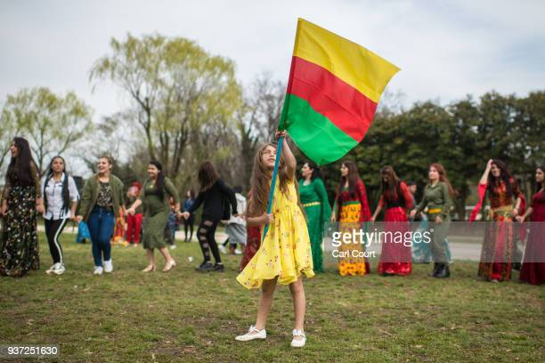 A young girl waves the flag of the Democratic Federation of Northern Syria during Nowruz celebrations on March 24 2018 in Tokyo Japan Nowruz meaning...