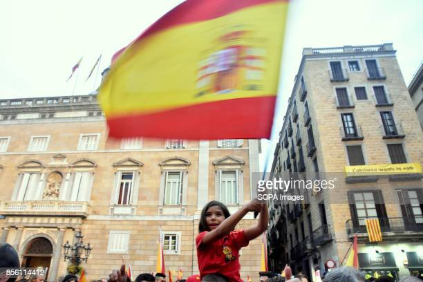 A young girl waving the flag of Spain during the demonstration against the independence of Catalonia About 5500 according to the Guardia Urbana and...