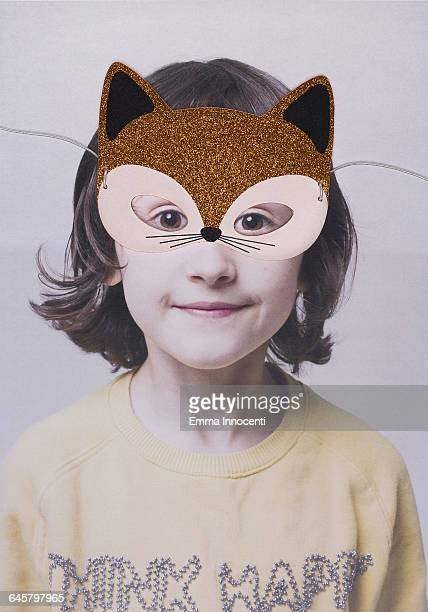 Young girl wearing a cat mask