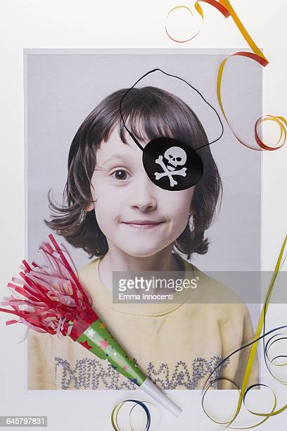 Young girl wearing a pirates eye patch