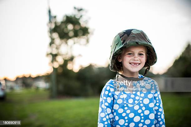 young girl wearing army helmet