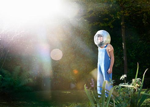 young girl wearing astronaut helmet - gettyimageskorea