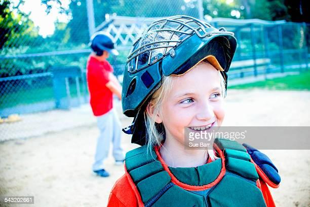 Young girl wearing baseball kit