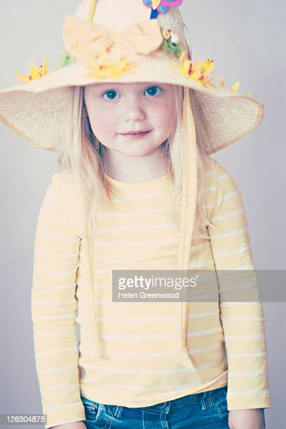 young girl wearing easter bonnet - easter bonnet stock pictures, royalty-free photos & images