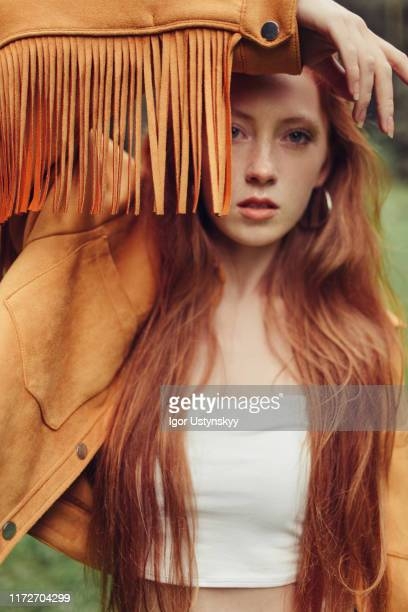 young girl wearing fringed suede jacket - fringing stock pictures, royalty-free photos & images