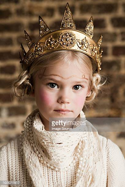 Young girl wearing gold crown