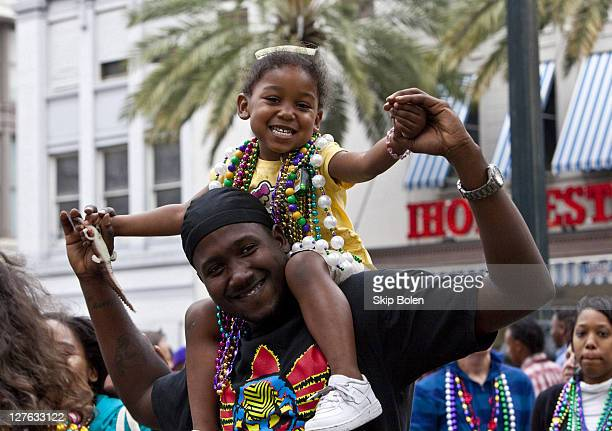 A young girl wearing Mardi Gras beads that she caught on Canal Street at the 2011 Mardi Gras Fat Tuesday Celebrations on March 8 2011 in New Orleans...