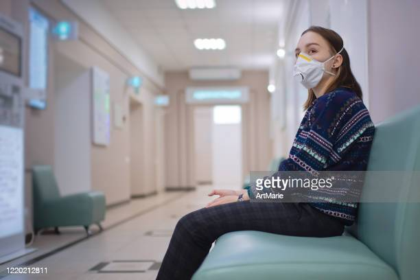 young girl wearing protective mask in medical clinic - outpatient care stock pictures, royalty-free photos & images