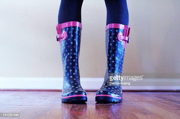 Young girl wearing rainboots