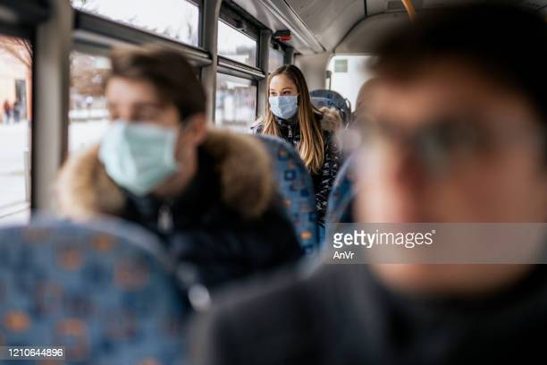 young girl wearing sterile face mask using a public transport - protective face mask stock pictures, royalty-free photos & images