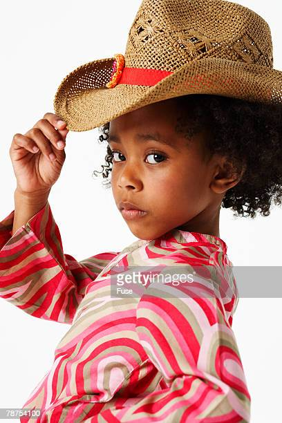 Young Girl Wearing Straw Cowboy Hat
