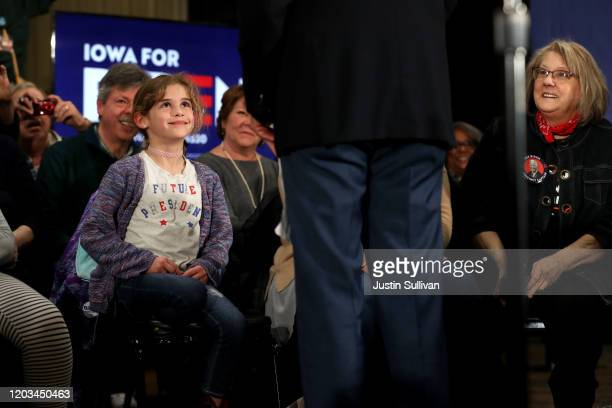 """Young girl wears a shirt that says """"future president"""" Democratic presidential candidate former Vice President Joe Biden talks with her during a..."""
