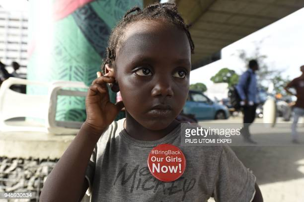 A young girl wears badge to press for the release of the remaining 112 out of 219 kidnapped Chibok schoolgirls ahead of the fourth anniversary of...