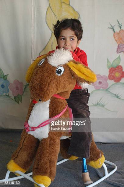A young girl who lost a limb when an earthquake struck the city plays in a tent in Bam Iran 8th November 2004 The 2003 Bam earthquake was a major...
