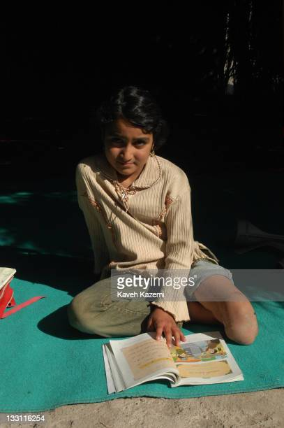 A young girl who lost a limb when the earthquake struck the city studies in a makeshift school in a tent in Bam Iran 8th November 2004 The 2003 Bam...