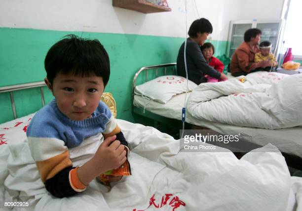 A young girl who suffers from the hand foot and mouth disease caused by the enterovirus 71 undergoes treatment in a hospital on April 28 2008 in...