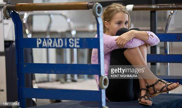 A young girl who would not give her name sits on a luggage trolley near the Air Australia ticket counter at Honolulu International Airport on...