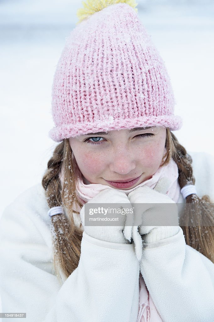 Young girl winking in the snow. : Stock Photo
