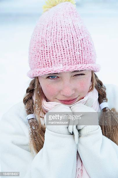 "young girl winking in the snow. - ""martine doucet"" or martinedoucet stock pictures, royalty-free photos & images"