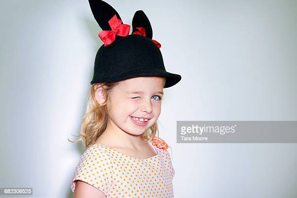 young girl winking to camera