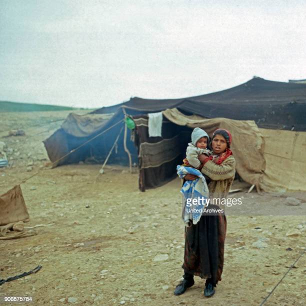 A young girl with a baby on her arms at a bedouin camp Israel late 1970s
