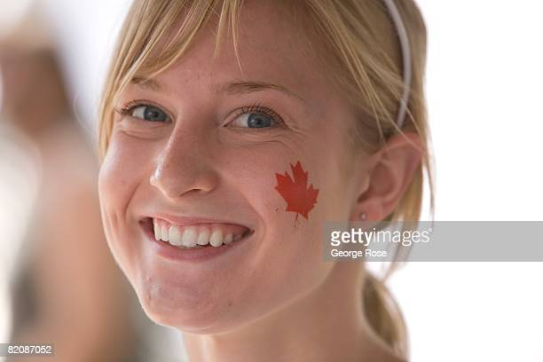 A young girl with a Canadian maple leaf flag sticker on her cheek waits for the Canada Day festivities to begin in this 2008 Penticton British...