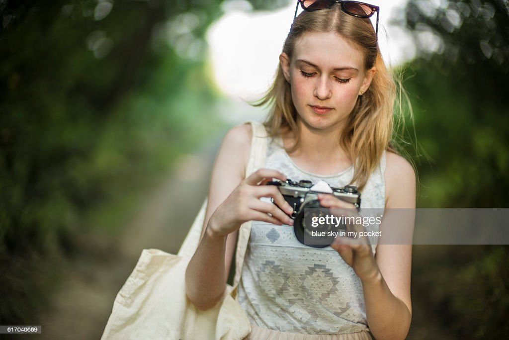 A young girl with a film camera. : Stock Photo