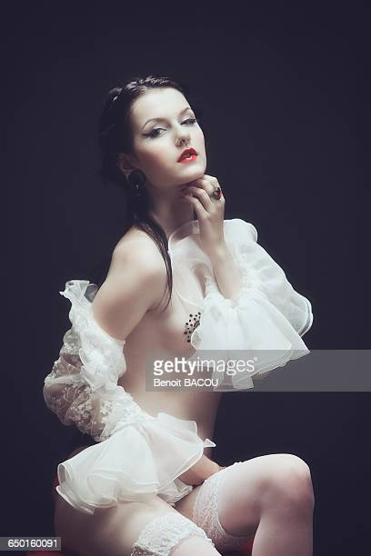 young girl with a lace top with frill burlesque, hand under chin - victorian erotica stock photos and pictures