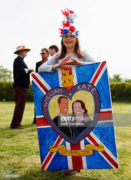 A young girl with a painting of the royal couple at her street party in the village of Yardley Hastings on April 29 2011 in Northamptonshire England...