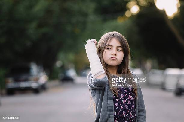 Young girl with a plaster arm