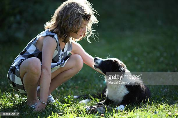 young girl with a pup - martial stock pictures, royalty-free photos & images
