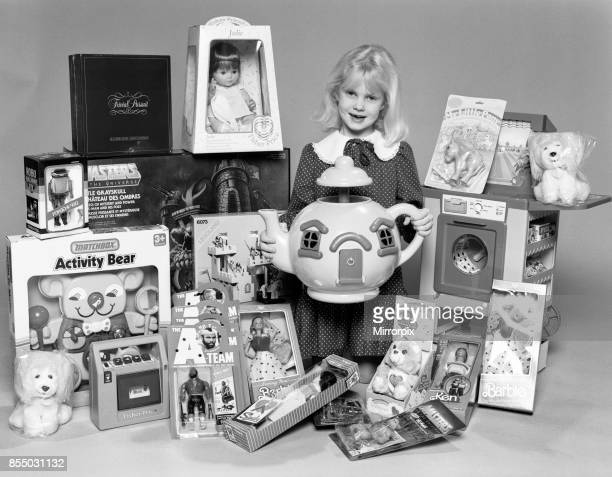 A young girl with a selection of children's toys for Christmas 6th December 1984