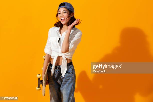 young girl with a skateboard - china east asia stock-fotos und bilder