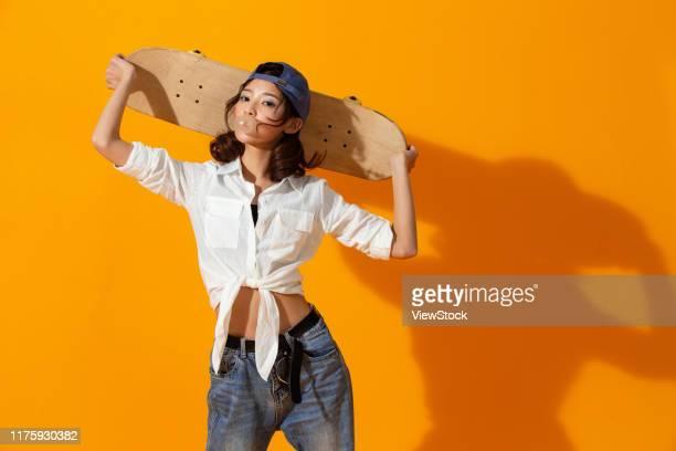 young girl with a skateboard - china east asia imagens e fotografias de stock