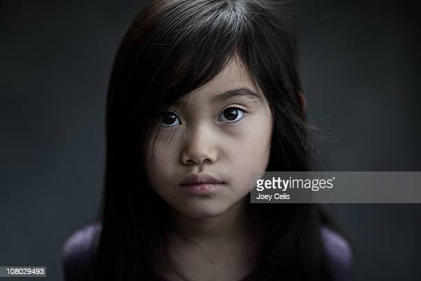 Young girl with a somber expression