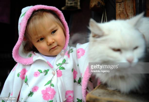 A young girl with a white cat on August 21 2013 in Sirince Turkey The village of Sirince is believed by New Age mystics to be a site of positive...