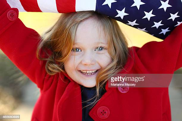 young girl with an american flag - blue coat stock pictures, royalty-free photos & images