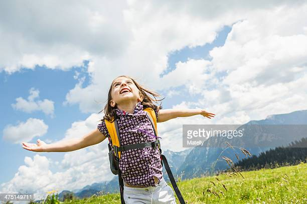 Young girl with arms out, Tyrol, Austria