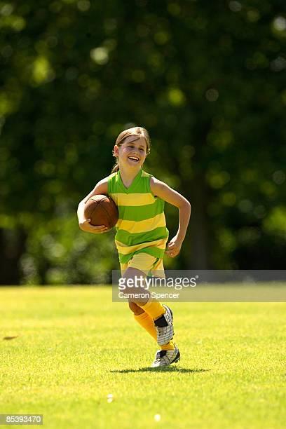 Young girl with Australian football