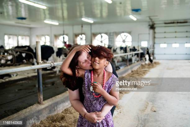 """young girl with autism connecting with cows. - """"martine doucet"""" or martinedoucet stock pictures, royalty-free photos & images"""