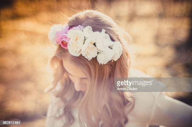 young girl (16-17) with band of flowers in her hair - girl band stock pictures, royalty-free photos & images