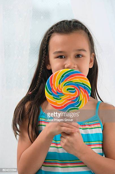 Young girl with big lollipop