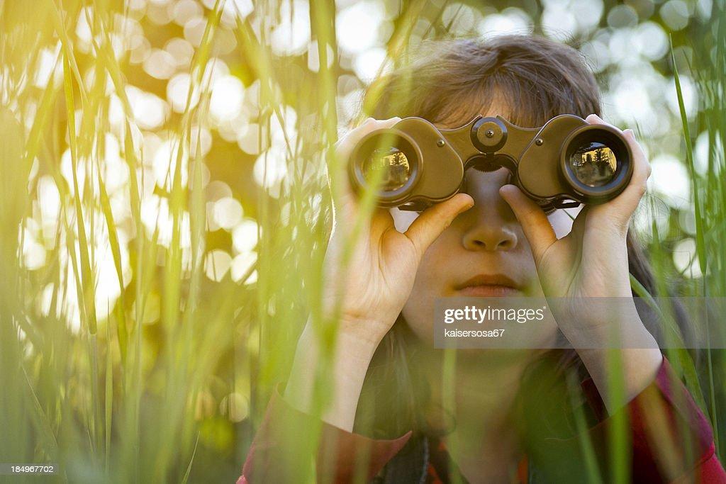 Young girl with binoculars : Stock Photo