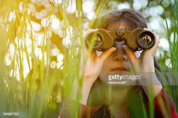 Young girl with binoculars