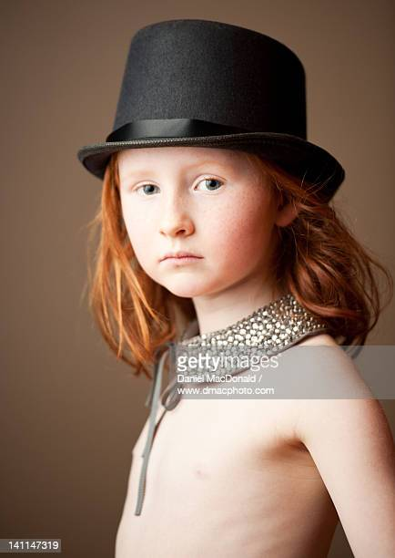Young girl with black top hat