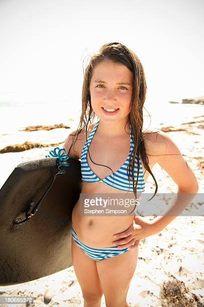 young girl with boogie board at the beach