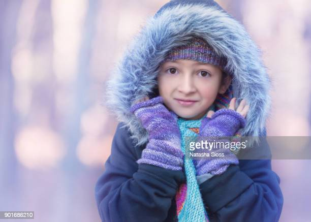 young girl with brown hair and brown eyes standing outdoors in the winter - hairy little girls stock photos and pictures