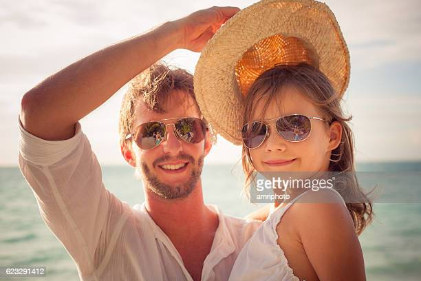 young girl with cool dad on summer day