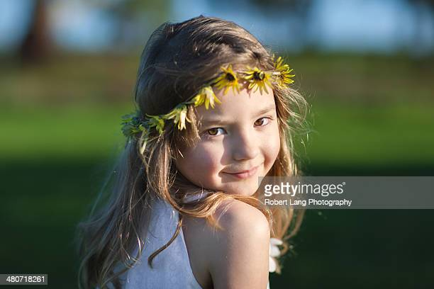 Young girl with daisy chain in her hair