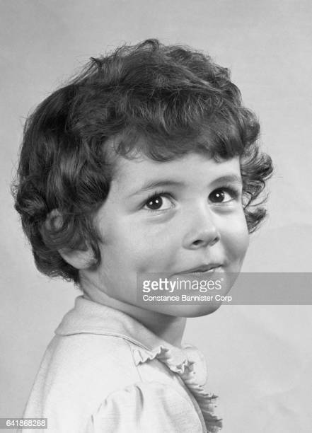 young girl with dimples - constance bannister stock photos and pictures